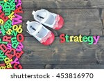 strategy word on wooden table | Shutterstock . vector #453816970