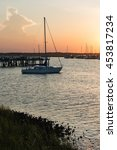 small sailboat at sunset on the ... | Shutterstock . vector #453817234