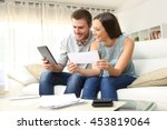 happy couple checking bank... | Shutterstock . vector #453819064