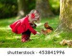 little girl in red trench coat...   Shutterstock . vector #453841996