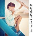 cute little girl with a glass... | Shutterstock . vector #453947539