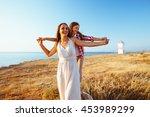 family walking on the evening... | Shutterstock . vector #453989299