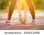 fitness woman stretching her... | Shutterstock . vector #454012498
