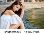 young attractive woman near the ... | Shutterstock . vector #454024906