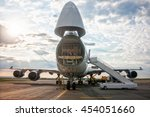 Small photo of Unloading wide-body cargo airplane