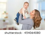 happy young mother and her son  | Shutterstock . vector #454064080