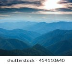 mountain range covered with... | Shutterstock . vector #454110640
