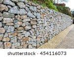 wire gabion rock fence. metal... | Shutterstock . vector #454116073