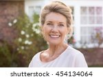 Happy Senior Woman Standing...
