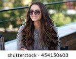 trendy dressed fashionable girl ... | Shutterstock . vector #454150603
