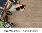 top view of travel stuff on...   Shutterstock . vector #454154104