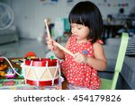 little girl playing drum at... | Shutterstock . vector #454179826