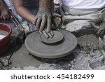 a men's hands guiding a child... | Shutterstock . vector #454182499