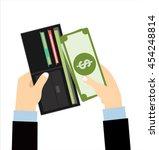 human hands putting cash... | Shutterstock .eps vector #454248814
