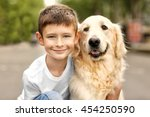small boy and cute dog on street | Shutterstock . vector #454250590