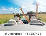 couple enjoying a drive in a... | Shutterstock . vector #454257433