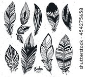 hand drawn boho feathers set.... | Shutterstock .eps vector #454275658