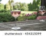 wine glasses on table at garden | Shutterstock . vector #454315099