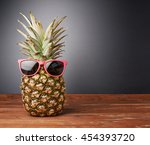 raw whole pineapple in red... | Shutterstock . vector #454393720