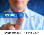 approved concept. person touch... | Shutterstock . vector #454458574