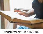 closeup woman hand holding a... | Shutterstock . vector #454463206
