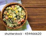 Stock photo quinoa salad with sweet corn olive tomato cucumber and chives in wooden bowl photographed 454466620