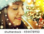 young woman with glass of... | Shutterstock . vector #454478950