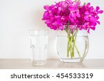 water glass with orchid flower... | Shutterstock . vector #454533319