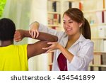 man getting physical arm...   Shutterstock . vector #454541899
