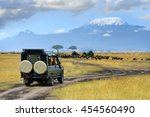 Small photo of Safari game drive with the wildebeest, Masai mara reserve in Kenya, Africa