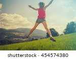 girl enjoying in a countryside... | Shutterstock . vector #454574380