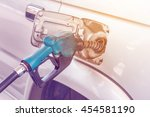 closeup of pumping gasoline... | Shutterstock . vector #454581190