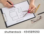 woman paints a house plan | Shutterstock . vector #454589050