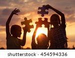 silhouette of three happy... | Shutterstock . vector #454594336