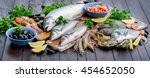 Raw Seafood On A Wooden Table....