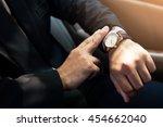 businessman seats on the car... | Shutterstock . vector #454662040