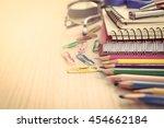 school supplies on wooden table ... | Shutterstock . vector #454662184