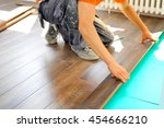 worker carpenter doing laminate ... | Shutterstock . vector #454666210