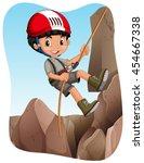 boy climbing up the mountain... | Shutterstock .eps vector #454667338