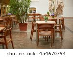 tables of street cafes in italy | Shutterstock . vector #454670794