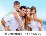 happy family on beach. | Shutterstock . vector #454743130