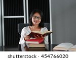 asian woman reading a book in... | Shutterstock . vector #454766020
