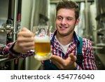 brewer holding a glass of pint...   Shutterstock . vector #454776040
