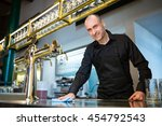 portrait of happy bar tender... | Shutterstock . vector #454792543