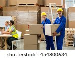 smiling workers looking at... | Shutterstock . vector #454800634