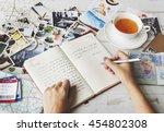 Hands Writing Travel Journal...