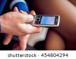 hand with old mobile phone ... | Shutterstock . vector #454804294