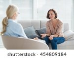 woman talking to therapist on... | Shutterstock . vector #454809184