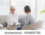 smiling therapist with woman on ... | Shutterstock . vector #454809730