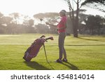 side view of woman carrying... | Shutterstock . vector #454814014